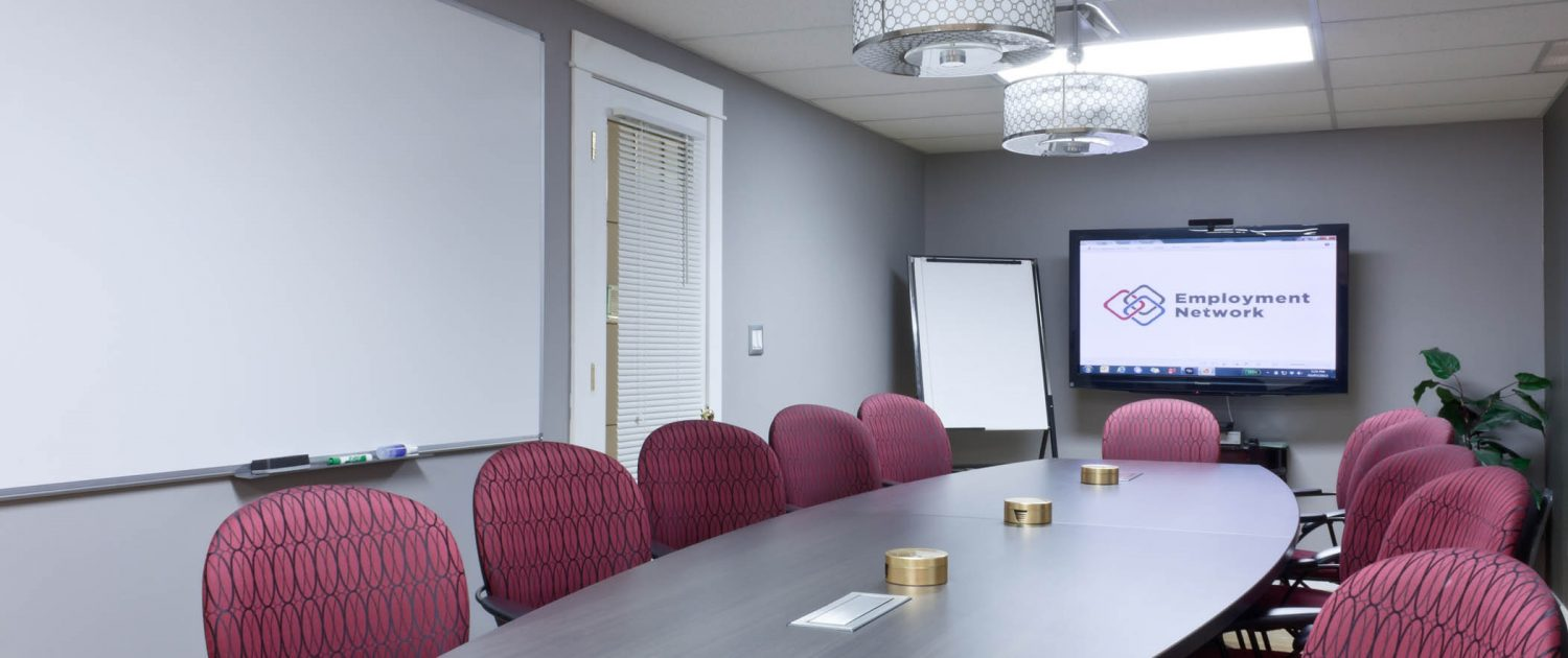 boardroom 12 red chairs long table tv screen on far wall
