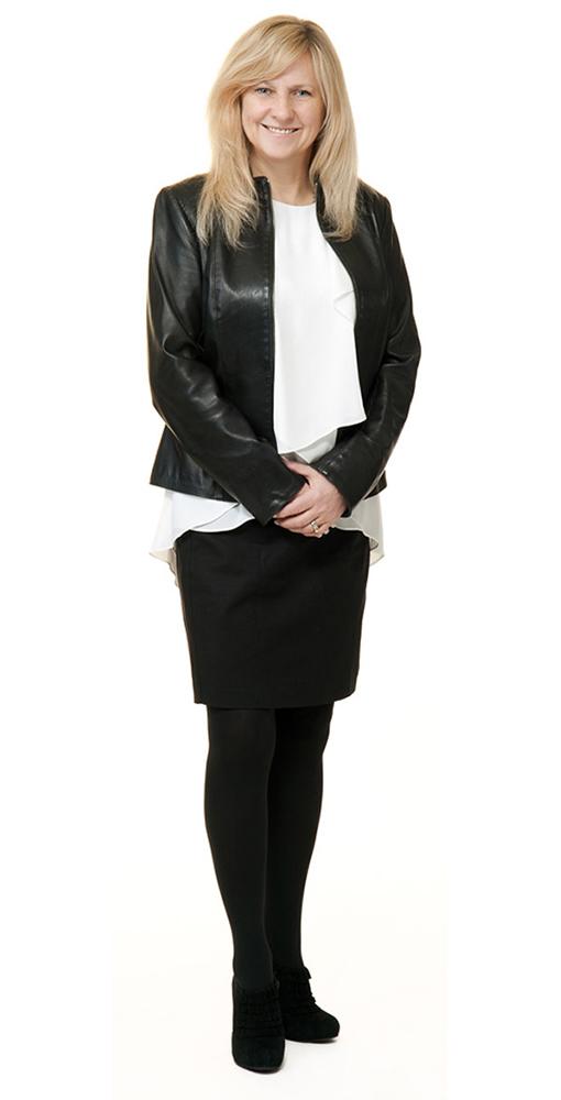 Elan standing in black outfit smiling