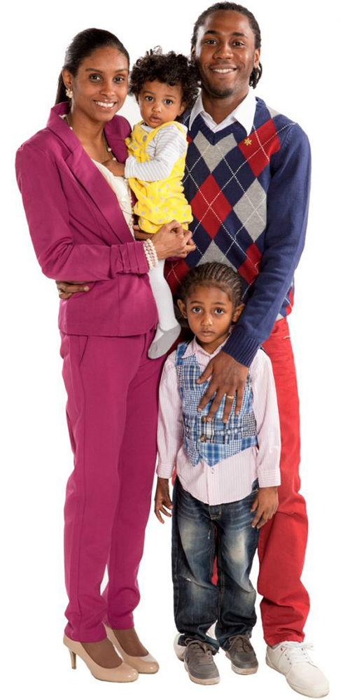 Sheldon and Trudy and two children standing together smiling