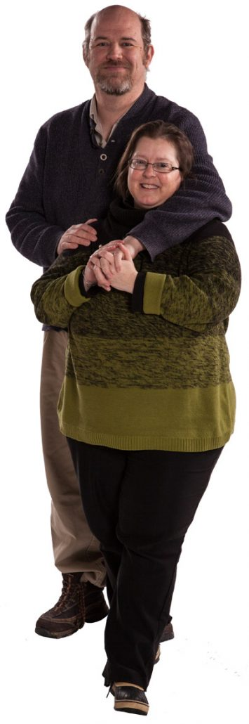 Trent and Julie standing together smiling
